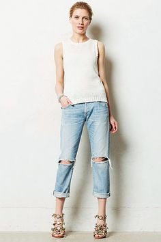 The Distressed Boyfriend Jean We all know that a pair of dark-wash skinnies can make us look amazing, but don't discount the boyfriend jean just yet. A perfectly distressed style teamed with heels and a tank is equally alluring.