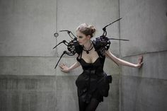 Perched on the wearer's shoulders are animated robotic limbs that eerily crawl around the body. The robotic dress both incites the curiosity of passersby by coyly dancing around the wearer's body while at the same time protecting the wearer if somebody approaches too fast or comes to close.