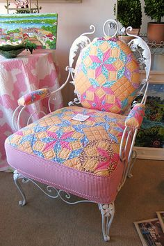 Well, damn! If I had thought to use a pre-made quilt to reupholster my chair, it would have saved me a lot of work!