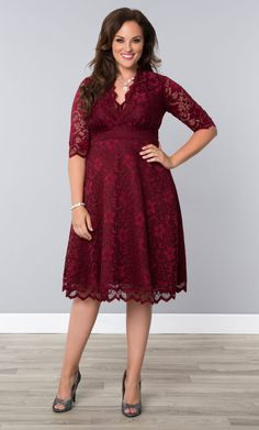 Pour a tall glass of style in our plus size Pinot Noir Mademoiselle Lace Dress. Gorgeous scalloped lace, A-line silhouette and in a rich color; it's the perfect cocktail dress! Shop our entire made in the USA collection at www.kiyonna.com. #PlusSizeFashion