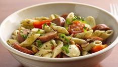 Looking for a delicious Italian-style dinner? Then check out this cheesy sausage salad made using Suddenly Salad® basil pesto pasta salad mix!