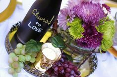 decorating wine bottles for bridal shower | The vineyard wedding invitations have a grape motif, green and purple ...