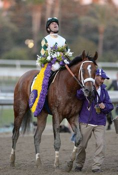 Gary Stevens reacts atop MUCHO MACHO MAN after winning the Classic.