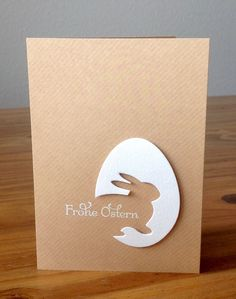 "handmade Easter card ... Stanze ""Grand Bunny"" von poppystamp und Ei von Sizzix ... minimalist look of graphic art ... textured kraft background ... negative space bunny off the edge on die cut egg ... fab design"