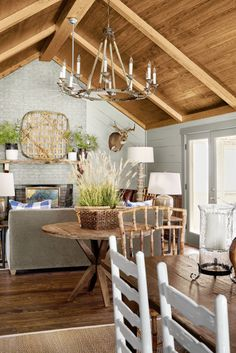 """""""Tall ceilings, bold plant arrangements, and large light fixtures have even more impact in a small home. Play with scale to find what feels right,"""" says designer James Farmer. Country Farmhouse Decor, Farmhouse Interior, Farmhouse Style, Modern Farmhouse, Rustic Chandelier, Chandelier Ideas, Rustic Lighting, Chandeliers, Interior Design Advice"""