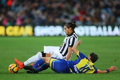 Alessandro del Piero of the All Stars tackles Martin Caceres of...