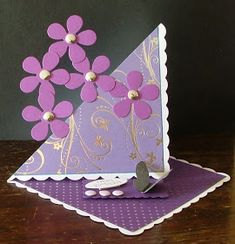 I must admit I am loving these twisted easel designs, especially when combining them with 'off the page' elements like these purple flowe...