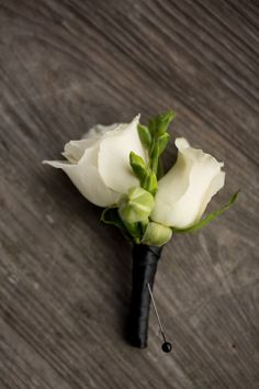 I love boutonnieres like this!!! These are my style too!! Sweet, simple, and classy...and not a huge rose!!!