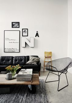 The graphic expression, with type, vintage leather couch and iconic chair :: A Bertoia Wire Diamond Chair