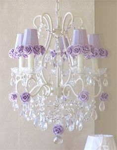 The 5 Light Chandelier with Lavender Rose Shades is a lovely vintage-inspired design.  Chandelier is painted antique white and adorned with luxurious pink silk dupioni shades that are trimmed in Mulberry paper roses