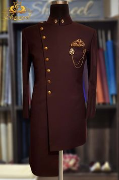 Indo Western Bespoke Prince Suit Premium Quality Self Motive with Antique Brass Buttons by Shameel Khan Exclusively available for orders at Shameel Khan Inbox us or 📞 for pricing and Free Designer's Appointment. Wedding Kurta For Men, Wedding Dresses Men Indian, Wedding Dress Men, Wedding Suits, Indian Men Fashion, Mens Fashion Suits, African Fashion, Dress Suits, Men Dress
