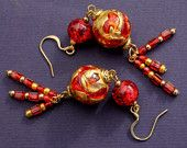 Red and gold glass bead drop earrings.  The main red and gold beads are genuine Murano glass beads I sourced from Venice on one of my trips.  These earrings are perfect for any festivities.  The tassels are made from three drops of red and gold seed beads.  Earrings measure 9 cm / 3.5 inches. https://www.etsy.com/shop/AmuseTheWind