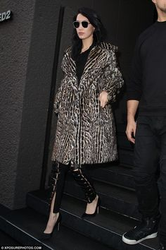 Ciao Bella: The younger sibling (20), led the way in a thick snow leopard print coat to keep out the Milan winter chill