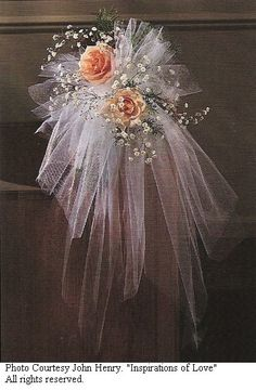 Google Image Result for http://www.wedding-flowers-and-reception-ideas.com/images/tulle-pew-bows-0001.jpg