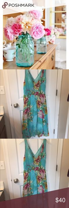 Turquoise Pink Floral Sundress Beautiful Tea Party Sundress in this aqua blue with Bright Bold Pink Flowers.  100% Cotton.  Cute all year round throw a Jean Jacket over it or a cardigan and you are set.  EUC! Pretty Pink Dresses Asymmetrical