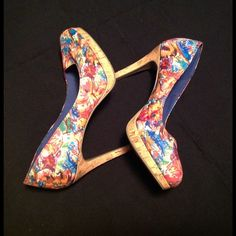 FIONI PATTERN CORK HEELS A very nice pair of heels that are brightly colored with stylized flowers. The heels are clean and in good condition. The heels are square and are  4 1/2 in. high. Very minimal wear, a size 9. FIONI Shoes Heels