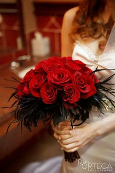 I do like this red rose bouquet with black feathers.