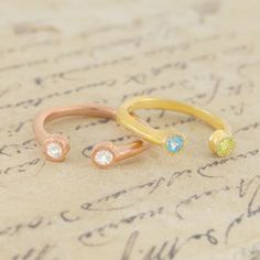 Beautifully uncomplicated and elegant, these 18k gold plated sterling silver stacking birthstone rings feature two semi-precious gemstones set into textured bezels. #Embersjewellery #Jewellery #ring #accessories