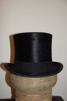 This is a wonderful Top Hat that was purchased in an antique shop 5 years ago to complete a costume for a Sweeney Todd party. The hat shows very