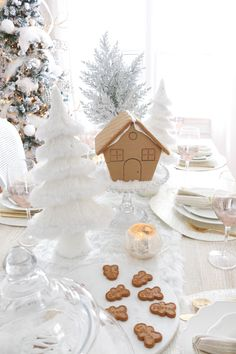 Pretty dining table with gingerbread house.