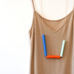 These stunning color-blocked necklaces are so pretty, and would spruce up my entirely neutral colors-based wardrobe.