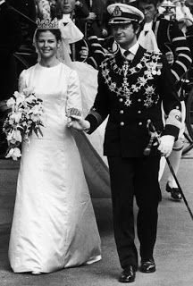 King Carl Gustaf married Miss Silvia Renate Sommerlath on 19 June 1976 in Stockholm Cathedral. Silvia chose to go to France for her wedding dress, to Dior and Marc Bohan. The result is a silk duchesse gown almost stark in its simplicity, with a high neck, long sleeves, slim skirt and train extending from the shoulders.