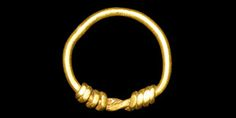 "Viking Gold Childs Ring. 9th-11th century AD.  A delicate finger ring formed from a round-section wire, the ends twisted about the hoop. 0.75 grams, 13mm overall, 10.65mm internal diameter (1/2"")"