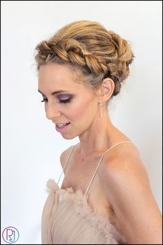 Wedding Updos Bridal Hairstyles - a wrap around dutch braid looks so cute on her!