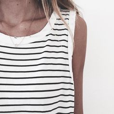 Striped tank, thick white binding trim and simple jewellery. Minimal and classic.