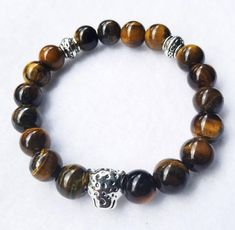2 filaments of stocky silver grains make a sophisticated wrap for the wrist. The little nuggets are improved with an imprinted gourd-like charm that hangs near the clutch. Handmade Bracelets, Handmade Jewelry, Beaded Bracelets, Tiger Eye Beads, Boho Accessories, Ankle Bracelets, Stone Beads, Silver Beads, Sterling Silver Bracelets