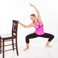 Stand to the right of chair with feet wider than hips, knees and toes turned out about 45 degrees. Lightly hold the back of the chair with right hand. Lower into a deep plié, bending knees over, but not past, toes as left arm reaches overhead. Lean torso slightly in toward chair.