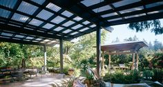 Large patio/pergola with corrugated roof. I like the pitch (away to the sides)