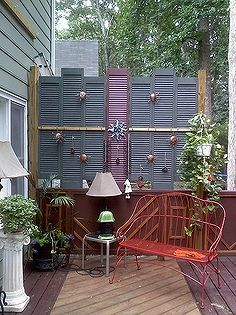 privacy on the deck, decks patios porches, outdoor living, repurposing upcycling, Old shutters at a garage sale for 2 makes a great screen on the deck