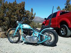 blue shovelhead chopper with king/queen seat and tall sissy bar