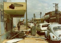 A view of Knuckey Street following Cyclone Tracy. A damaged shop front opposite Burns Philp, surrounded by debris. 1974 Darwin, Storms, Historical Photos, Burns, Xmas, Street View, Australia, History, Shop