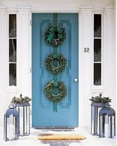 Be non-traditional by not only using one wreath, but pop your front door with three. Use a fun, decorative ribbon to hang the wreaths together. To make this interesting, rely on your local florist or nursery to give you advice and offer unique selections of holiday greens.