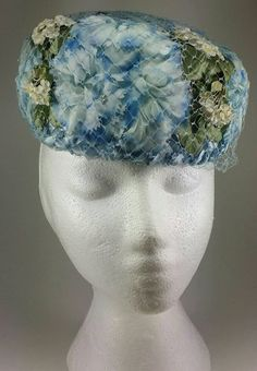 Check out this item in my Etsy shop https://www.etsy.com/listing/227425815/blue-floral-pillbox-hat-1960s-mid