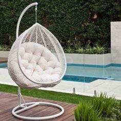 hanging egg chair might be cool in place of a traditional rocker rh pinterest com Outdoor Chair Cushions Outdoor Chair Cushions
