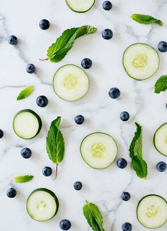 Blueberry Cucumber Sparkler, serves one: fresh blueberries cucumber slices lime club soda gin simple syrup
