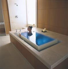 "Look at this tub!! It's the Kohler ""sok overflowing bath"" with chromatherapy (color therapy)."