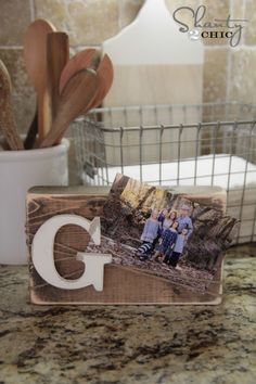 DIY Wood Block Frame by @shanty2chic. Great inexpensive gift ideas for the masses. Between teachers, neighbors and friends, finding these gift ideas allows us to give really great gifts at Christmas time without breaking the bank. Check out the $1 DIY Wood Block Frame! http://www.rustoleum.com/product-catalog/consumer-brands/varathane/varathane-fast-dry-wood-stain/