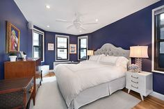 navy master bedroom - but NOT white bedding. Not when sharing a bed with a man. Maybe grey bedding or grey walls and navy bedding...Hmmmm...