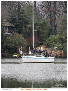 A solitary sailboat moored on Weems Creek in West Annapolis Maryland on a late winter morning. Photograph posted on February 28th 2013. To see a full size version of this photograph as well as the accompanying Annapolis Experience Blog article please click through on the Pinterest images for it. Picture Copyright © 2013 G J Gibson Photography LLC & article Copyright © 2013 Annapolis Experience