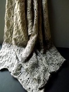 Elegance and warmth collide in this knit shawl pattern that features soft Icelandic wool and a delicate lace design. Worked horizontally as you would a wide scarf, the Natural Leaf Wrap is ideal for colder fall or winter weather and only requires straight knitting needles to complete.