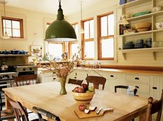 I love this farmhouse style kitchen, and I love the wooden table. I love everything about this room!