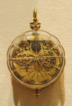 Watch Watchmaker: David Buschman  (1626–1701) Date: probably after 1657 Culture: German, Augsburg Medium: Case: rock crystal and gilded brass; Dial: gilded brass and silver, partly gilt; Movement: gilded brass and steel, partly blued Dimensions: Diam. 2 in. (5.1 cm)