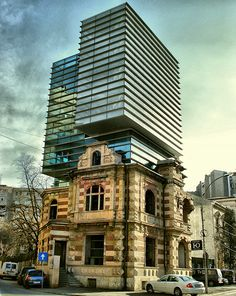 In Bucharest, an awesome building with a mix of old and new #architecture