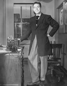 Zoot Suit: a men's suit with high-waisted, wide-legged, tight-cuffed, pegged trousers, and a long coat with wide lapels and wide padded shoulders.