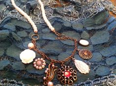 A personal favorite from my Etsy shop https://www.etsy.com/listing/193650133/bohemian-pearl-and-charm-necklace-boho