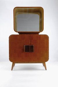 Bar Cabinet (1946) by Czech furniture designer Jindřich Halabala (1903-1978). Nutwood, glass, 150.5 x 94 x 48.5 cm.  Custom-made for the English market by Spojene UP Zavody, Hodonin. via deconet